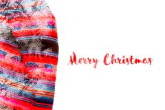 Festive Christmas holiday winter background with bright multicolor tablecloth. In traditional colors covered sparkling snowflakes on white backdrop. Inscription stock photography