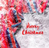 Festive Christmas holiday winter panoramic background with bright multicolor tablecloth in traditional colors covered sparkling s. Nowflakes on rustic wooden stock photos