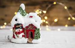 Festive Christmas house decoration with little snowman and backg Stock Photography