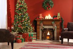 Festive Christmas interior. With fireplace and Christmas tree Royalty Free Stock Photos