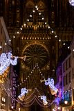 Christmas lights in front of Cathedrale Notre Dame in Strasbourg. Festive Christmas lights and decorations with blurred background in front of Chathedrale Notre stock image