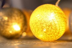 Festive Christmas lights on table,. Closeup Stock Images