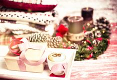 Festive Christmas and New Year composition. New Year and Christmas composition with a cup of cappuccino, wrapped gift, pine branches, coffee candles, warm Stock Image