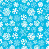 Festive Christmas and New Year seamless snowflakes pattern. Blue Stock Images