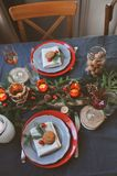 Festive Christmas and New Year table setting in red and grey tones. Dining place for celebration with handmade rustic details Stock Images