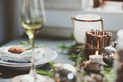 Festive Christmas and New Year table setting in scandinavian style with rustic handmade details in natural and white tones Stock Photo