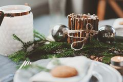 Festive Christmas and New Year table setting in scandinavian style with rustic handmade details in natural and white tones Stock Images
