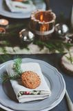 Festive Christmas and New Year table setting in scandinavian style with rustic handmade details in natural and white tones Stock Photos