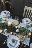 Festive Christmas and New Year table setting in scandinavian style with rustic handmade details in natural and white tones Stock Image