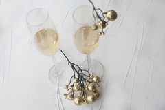 Festive Christmas newyear champagne glasses with gold glittery decoration. Two festive Christmas newyear champagne glasses with gold glittery decoration royalty free stock photo
