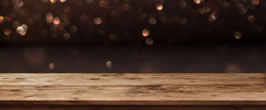 Festive Christmas Panorama with shimmering light. And bokeh against a wooden table stock photos