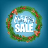 Festive Christmas sale wreath with mistletoe, tree cone, bow, lettering. Royalty Free Stock Photography