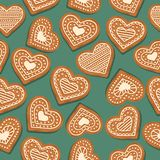 Festive Christmas seamless pattern with gingerbread hearts royalty free illustration