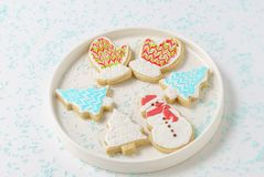Festive Christmas snowman Cookie with decorated trees on white background. Royalty Free Stock Image