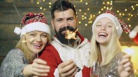 Festive Christmas sparkler decoration lighting element. Positive human emotions facial expressions.