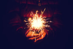 Festive Christmas sparkler in hand Stock Photography