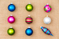 Festive Christmas still life with tree ornaments. Festive Christmas still life with colorful Xmas tree ornaments arranged in neat rows of baubles with a single stock image