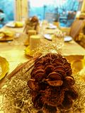 Festive Christmas table with pinecone decoration