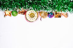 Festive Christmas toys and green tinsel bright garland isolated on white background. Stock Photos