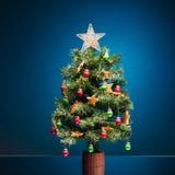 Festive Christmas tree on blue background stock photo