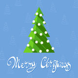 Festive Christmas Tree. Christmas tree on a blue background with the words Merry Christmas Stock Photos