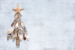 Festive Christmas tree made of shells royalty free stock images