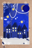 Festive Christmas village greeting card. Decorative blue paper applique collage greeting card of a festive Christmas winter village with illuminated houses Royalty Free Stock Photography