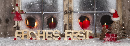 Festive Christmas window decoration with red candles. Royalty Free Stock Photo