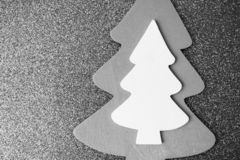 Festive Christmas Christmas winter happy beautiful black and white background with a small toy wooden homemade cute Christmas tree royalty free stock photos