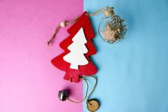 Festive Christmas winter blue pink background small toy wooden homemade cute Christmas tree and a round Christmas tree toy, a ball stock photos