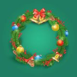 Festive Christmas wreath with balls, bells, mistletoe, tree cone and bow. Stock Images
