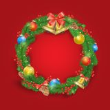 Festive Christmas wreath with balls, bells, mistletoe, tree cone and bow. On the red background Stock Photos