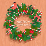 Festive christmas wreath with candy, bullfinch and wooden letter Royalty Free Stock Photography