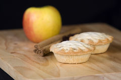Festive cinnamon and apple pies Stock Photos
