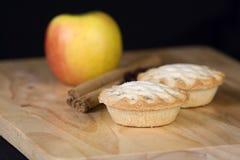 Festive cinnamon and apple pies Stock Photos