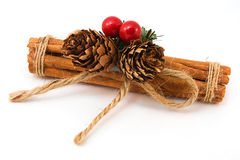 Festive Cinnamon stick decoation over white Stock Photos
