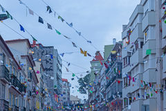 Festive city street with decoration of the flags in evening Stock Photo