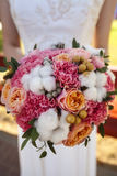 Festive close-up wedding bouquet roses cotton Bridal Dress Royalty Free Stock Images
