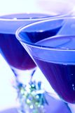 Festive Cocktails - Blue Tone. Closeup view of full cocktail glasses done in blue tone stock photo