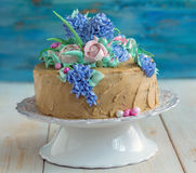 Festive coffee cake with flowers of cream. Royalty Free Stock Photography