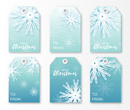 Festive collection of blue Christmas labels. Ready-to-use gift tags. Xmas and New Year Set of 6 printable origami holiday label. Vector seasonal badge design Royalty Free Stock Photos