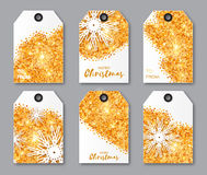 Festive collection of gold glitter texture Christmas labels. Ready-to-use gift tags. Xmas and New Year Set of 6 printable origami holiday label. Vector Royalty Free Stock Images