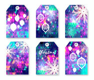 Festive collection of neon polygonal Christmas labels with snowflakes. Stock Photos