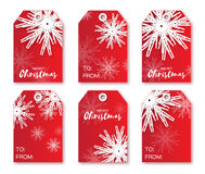 Festive collection of red Christmas labels. Ready-to-use gift tags. Xmas and New Year Set of 6 printable origami holiday label. Vector seasonal badge design Royalty Free Stock Photo