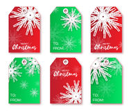 Festive collection of red, green Christmas labels. Ready-to-use gift tags. Xmas and New Year Set of 6 printable origami holiday label. Vector seasonal badge Stock Images