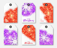 Festive collection of red purple glitter texture Christmas snowflake labels. Festive collection of red and purple glitter texture Christmas snowflake labels Stock Photos