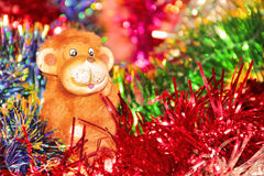 Festive colorful background with Christmas tinsel and fire monkey Royalty Free Stock Photos