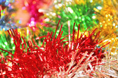 Festive colorful background with Christmas tinsel Royalty Free Stock Photos
