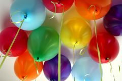 Festive colorful balloons for a good mood. Air, inflatable, balloons, holiday, bright, colorful, birthday, decoration, yellow, red, blue, purple, green, helium Royalty Free Stock Photo