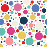 Festive colorful dotted seamless pattern. Random polka dot background.. Red, blue, yellow, green circles on white. Spotted abstract seamless pattern. Vector Royalty Free Stock Images